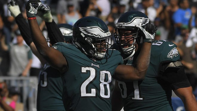 Philadelphia Eagles running back Wendell Smallwood (28) celebrates with teammates after scoring a touchdown during the second half of an NFL football game against the Los Angeles Chargers, Sunday, Oct. 1, 2017, in Carson, Calif. (AP Photo/Mark J. Terrill)