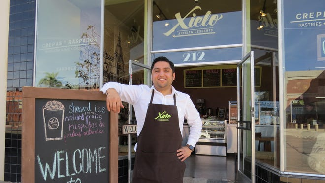 "Juan Carlos Ramirez poses outside Xielo Artisan Desserts, the combination cafe, coffeehouse and bakery he opened last month at the historic Woolworth Building in downtown Oxnard. Named for an alternative spelling of the Spanish word for ""heaven,"" the business specializes in sweet and savory items from Mexico, Spain, France and beyond."