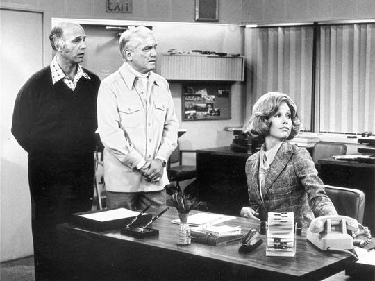 "Gavin MacLeod, Ted Knight, Mary Tyler Moore in ""The Mary Tyler Moore Show""  in 1975."