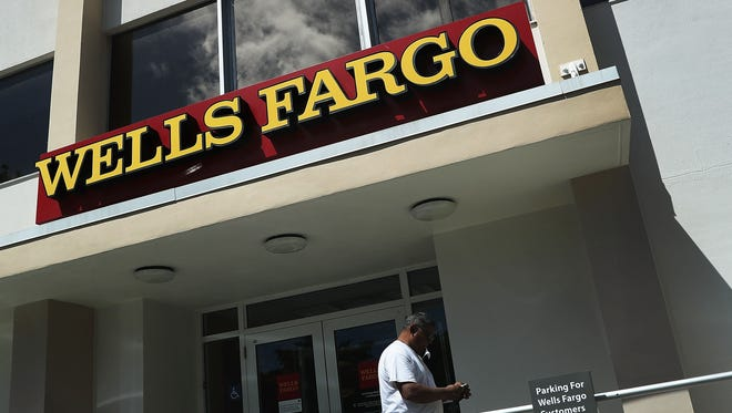 File photo taken in 2016 shows a Wells Fargo sign at one of the bank's branches in Miami, Florida.