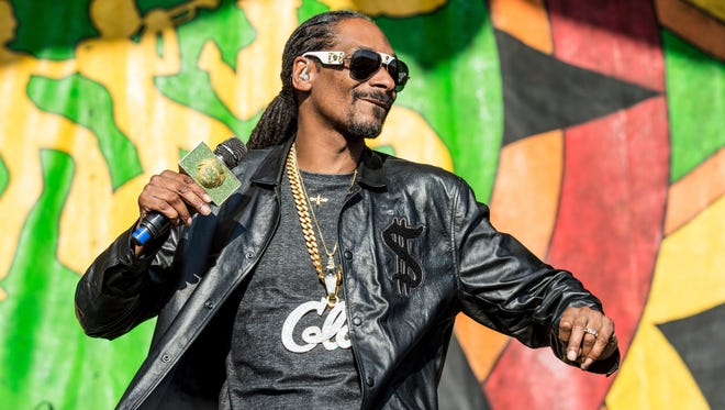 Snoop Dogg performs at the New Orleans Jazz and Heritage Festival on Saturday, May 6, 2017, in New Orleans.