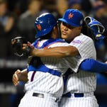 New York Mets relief pitcher Jeurys Familia (right) celebrates with catcher Travis d'Arnaud (7) after defeating the Kansas City Royals in game three of the World Series at Citi Field.