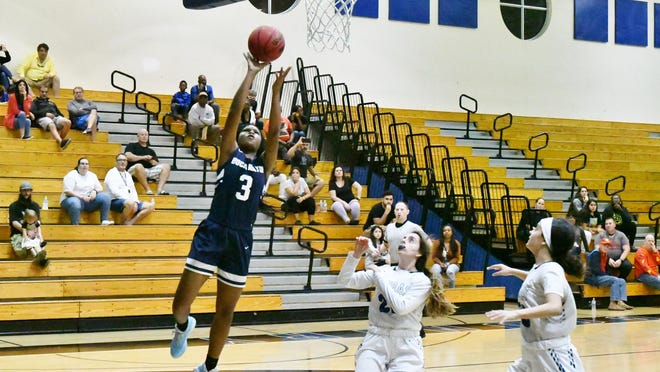 Boca Raton sophomore Martha Francillon goes up for a lay-up in the second quarter of Saturday night's game between the Boca Raton Bobcats and the Park Vista Cobras.