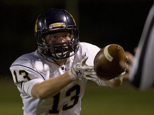 Wausau West's Davis Brinkmann reacts after intercepting the ball during the Valley Football Association football game against Wausau East at Thom FIeld in Wausau, Friday, Oct. 2, 2015. Wausau West defeated Wausau East 20-7.