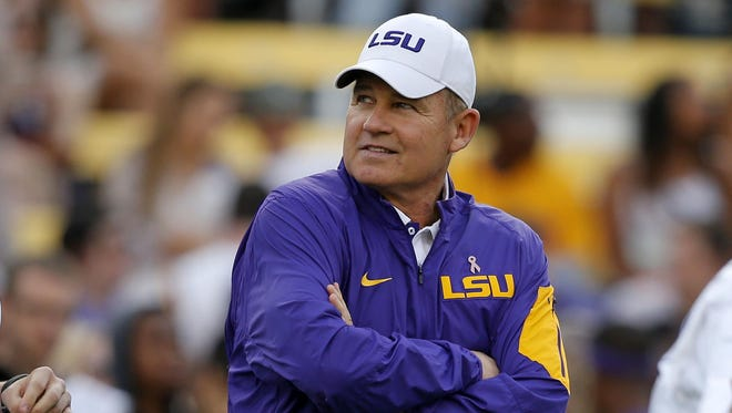 LSU football coach Les Miles watches his team warm up before a game against Florida on Oct. 17, 2015.