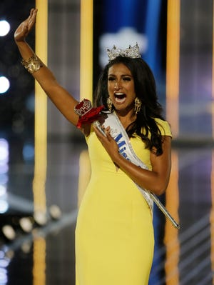 Miss New York Nina Davuluri walks down the runway after winning the the Miss America 2014 pageant on Sunday in Atlantic City.