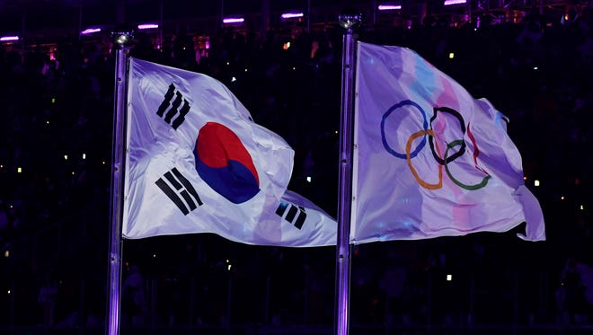 The Olympics flag is raised during the Opening Ceremony for the Pyeongchang 2018 Olympic Winter Games.