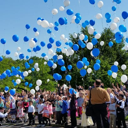 May 22, 2015: Students released 610 balloons representing