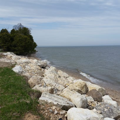 Newly-placed rocks help curb erosion on South Lake