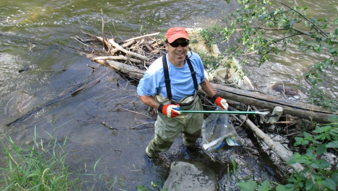 Cleanup projects such as this one on the Clinton River are just one of the many ways Michiganders can do their part for habitat conservation.