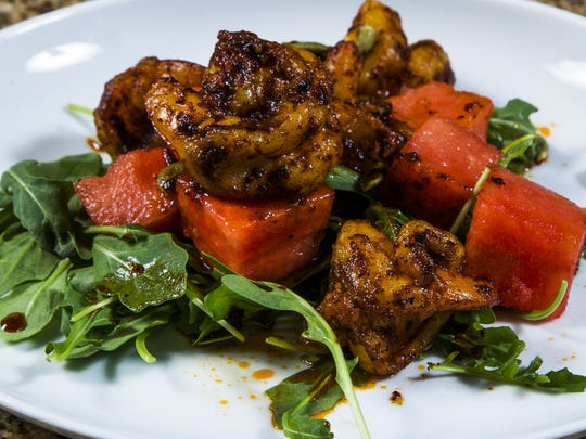 Top Home Chef finalist Laura Licona's charred chile shrimp with watermelon and pumpkin seeds.