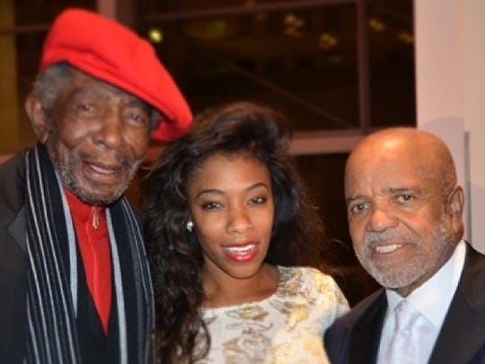 Robert Bateman, left, with Motown founder Berry Gordy Jr. (right) and great-niece Lauren Stovall.