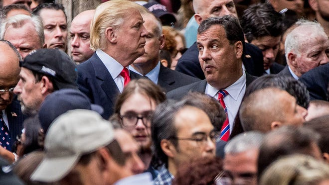 Republican presidential candidate Donald Trump, left, speaks with New Jersey Gov. Chris Christie, right, as he attends a ceremony at the Sept. 11 memorial, in New York, Sunday, Sept. 11, 2016, on the 15th anniversary of the Sept. 11 attacks.