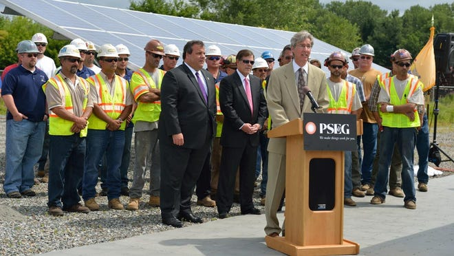 Public Service Enterprise Group Chairman and CEO Ralph Izzo, joined by Gov. Chris Christie, announcing a solar farm in Hackensack in July 2012.