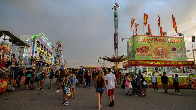 Sky darkens at the Champlain Valley Fair on Wednesday evening August 29, 2018.