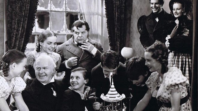 "June Lockhart, left, looks at Reginald Owen as Scrooge. Gene Lockhart at center in ""A Christmas Carol,"" 1938."