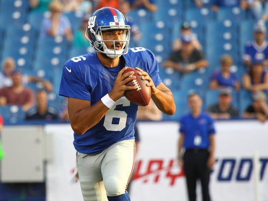 FILE - In this Aug. 20, 2016, file photo, New York Giants quarterback Logan Thomas (6) looks to pass against the Buffalo Bills during the fourth quarter of a preseason NFL football game, in Orchard Park, N.Y. The Buffalo Bills have signed Logan Thomas, a former quarterback who's making the switch to tight end, off of the Detroit Lions' practice squad. The Bills become Thomas' second team in three days. He was signed Monday by the Lions, who listed him as a tight end. (AP Photo/Jeffrey T. Barnes, File)