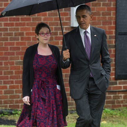 President Barack Obama walks with Kelly Bryant at her