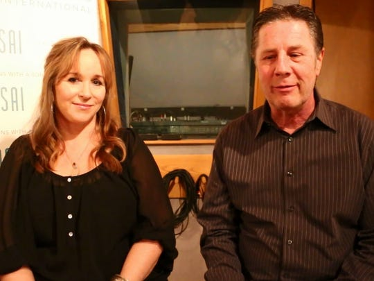 Gretchen Peters, left, talks with Bart Herbison about