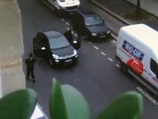 French police officer killed by gunmen