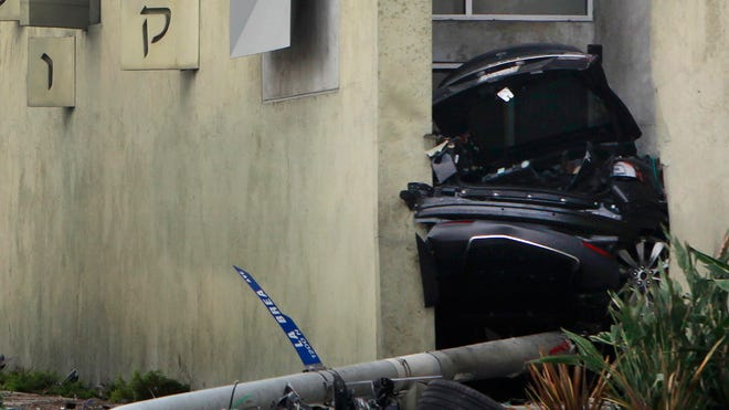 The remains of a car crash involving a Tesla, in West Hollywood, Calif., on Friday.