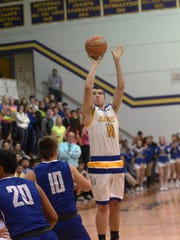 Lincoln's Darian Bishop shoots a 3-pointer during the