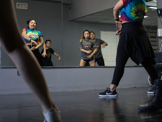 Founder Jenny Espino leads a group of students in a