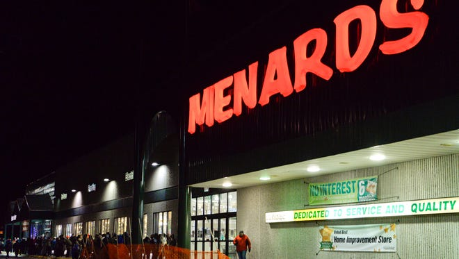 File - Shoppers wait outside at Menards in Manitowoc for the doors to open at 6 a.m. for the Black Friday six-hour sale in November 2014.