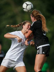 Valley junior Hannah Olson, left, collides with Ankeny