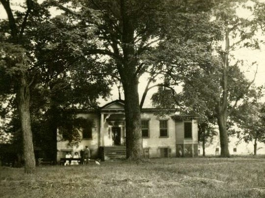"A Filson Historical Society photo ""At 'Calorama' near Louisville, Ky. - July 16, 1911"" used in a Landmarks Commission staff report has been compared with newer photos of the house at 2833 Tremont Drive."