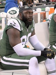 FILE - In this Nov. 26, 2017, file photo, New York Jets defensive end Muhammad Wilkerson reacts while sitting on the bench during the second half of an NFL football game against the Carolina Panthers, in East Rutherford, N.J. Wilkerson has been benched for the team's game at New Orleans on Sunday. Coach Todd Bowles said Friday, Dec. 15, 2017,  that Wilkerson will not travel with the team, saying repeatedly that it was a coach's decision and he's only worried about the players who will go up against the Saints. (AP Photo/Bill Kostroun, File)