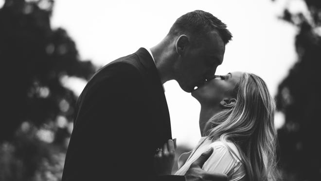 Olivia Harlan and Sam Dekker pose for their engagement photos last summer. The pair will be married in July in Door County.