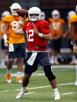 Quarterback Quinten Dormady throws to a receiver during practice Thursday, Aug. 31, 2017, in Knoxville, Tenn.  (WADE PAYNE/SPECIAL TO THE NEWS SENTINEL)