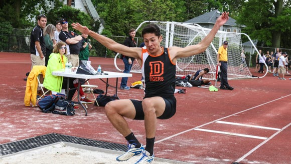 Dover senior Sebastian Cortes competes in the long