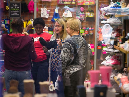 Kathy Bendle of Chesapeake Beach, Md., has been doing Black Friday shopping at Christiana Mall for 20 years with her family.