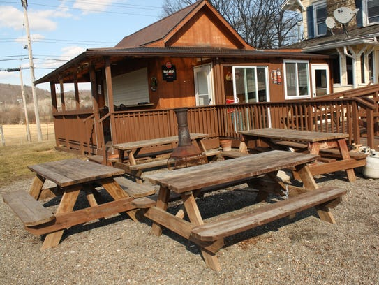 The outdoor seating area of the Blind Tiger Pub.