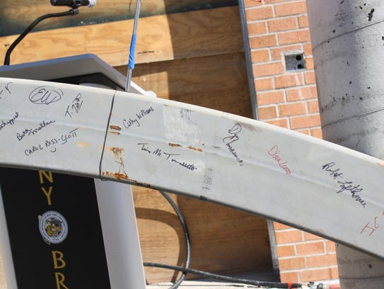 SUNY Broome officials signed the final piece of steel