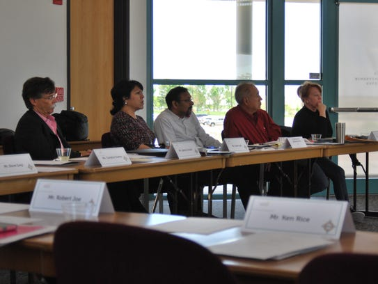 Panel members listen to a presentation during Discovery Day at the Zia Conference Center on Thursday.
