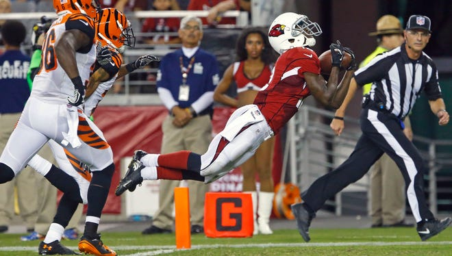 Arizona Cardinals wide receiver John Brown makes a diving catch for a touchdown against the Cincinnati Bengals during the third quarter of their NFL preseason game, Sunday, Aug. 24,  2014, in Glendale, Ariz.