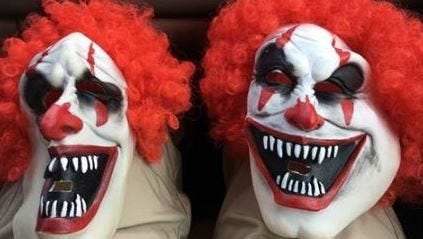 Clown masks used by two Troy-area high school students. The masks were confiscated by Troy Police Department.