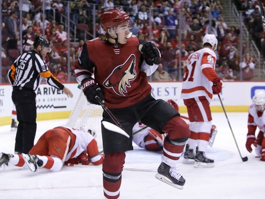 Arizona Coyotes center Clayton Keller reacts after scoring a second-period goal against the Detroit Red Wings during an NHL hockey game, Thursday, Oct. 12, 2017, in Glendale, Ariz. (AP Photo/Rick Scuteri)