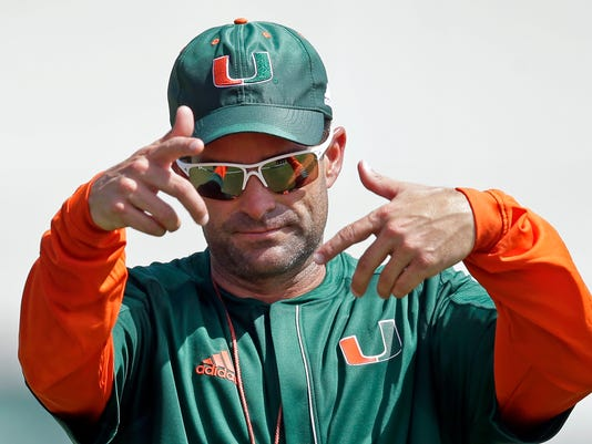 FILE - In this Aug. 4, 2016, file photo, Miami defensive coordinator Manny Diaz gives instructions to the players during NCAA college football practice in Coral Gables, Fla. Diaz has had successful stints at Mississippi State, Louisiana Tech and now Miami, where the Hurricanes went from awful to excellent defensively in their first year under Diaz. The 43-year-old is once again an up-and-comer in the business. (AP Photo/Alan Diaz, File)