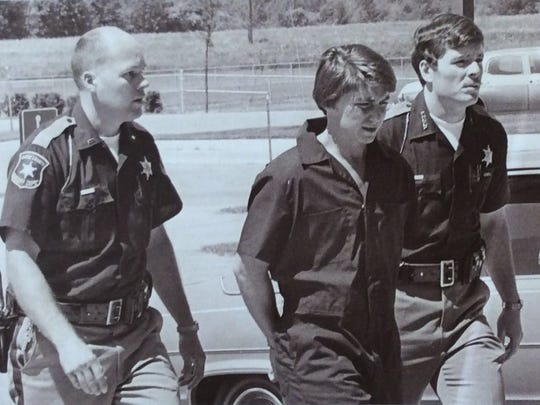 Don Miller is led into the Eaton County Courthouse in 1978. On the left is Lt. Paul Rogers and on the right is deputy Patrick Hutting, who would go on to become Eaton County sheriff.