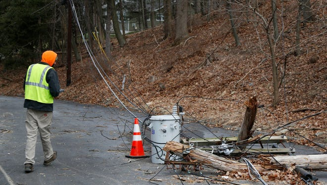 A contractor with the electric company looks at a downed transformer in Morristown, N.J., Monday, March 5, 2018.