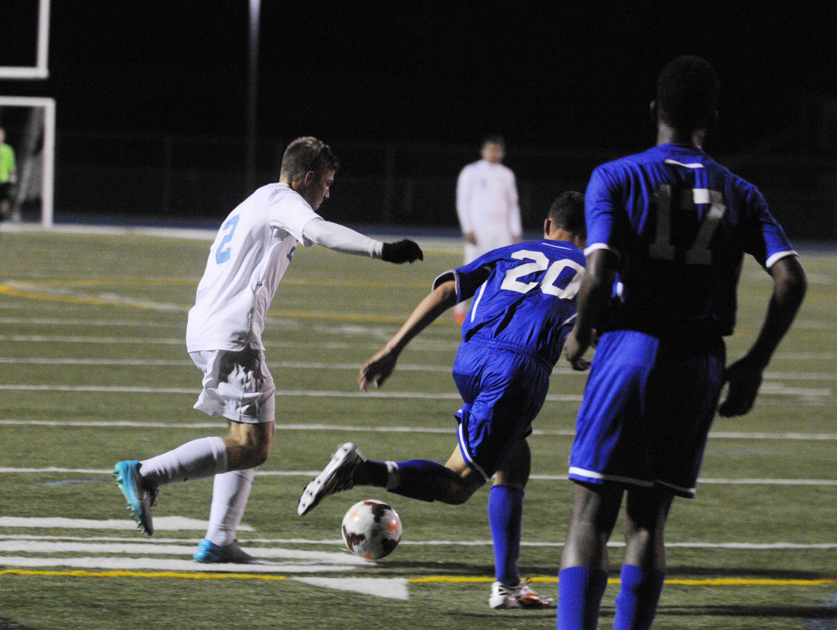 Cape Henlopen senior Jack Ashby (2) prepare to take a shot and score in the season finale against Dover.