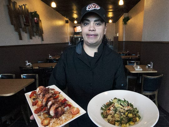 Chef Valerie Estala with two of her dishes from Fuzion