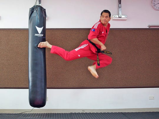 Philippines Taekwondo Champion Master Noly Caluag executes the jumping turning side kick.