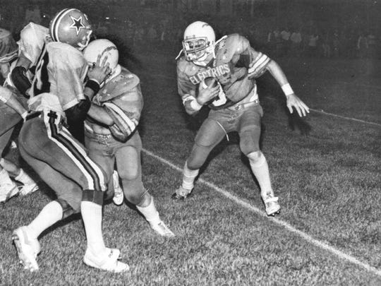 Philo's Greg Barker looks for running room with the help of a block from Pat Cooper in a 1982 game against Crooksville at Sam Hatfield Stadium. The Ceramics, who won the game 14-6 en route to an 8-2 regular season, and Electrics have won 39 times apiece in their 78-year rivalry.