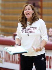 Arlington High School volleyball coach Maria Greenwood tries to get the attention of one her players during a match against Ketcham at Arlington in Freedom Plains on Monday.