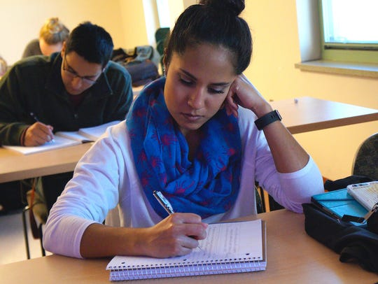 NMSU student Linda Dutchover writes a journal entry